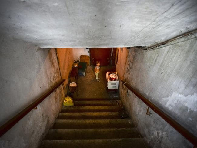Duck and cover ... A little girl walks the stairs of a bomb shelter in Petrovskiy district in Donetsk, eastern Ukraine, yesterday. Petrovskiy district of Donetsk has suffered the most from the artillery fights between Ukrainian army and Pro-Pussian rebels. Source: AP