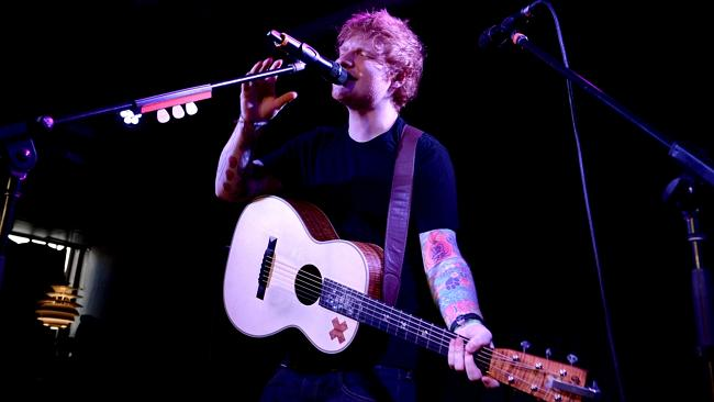 """Sweaty ... Singer Ed Sheeran plays a gig for 200 people in Melbourne""""s Ding Dong bar."""