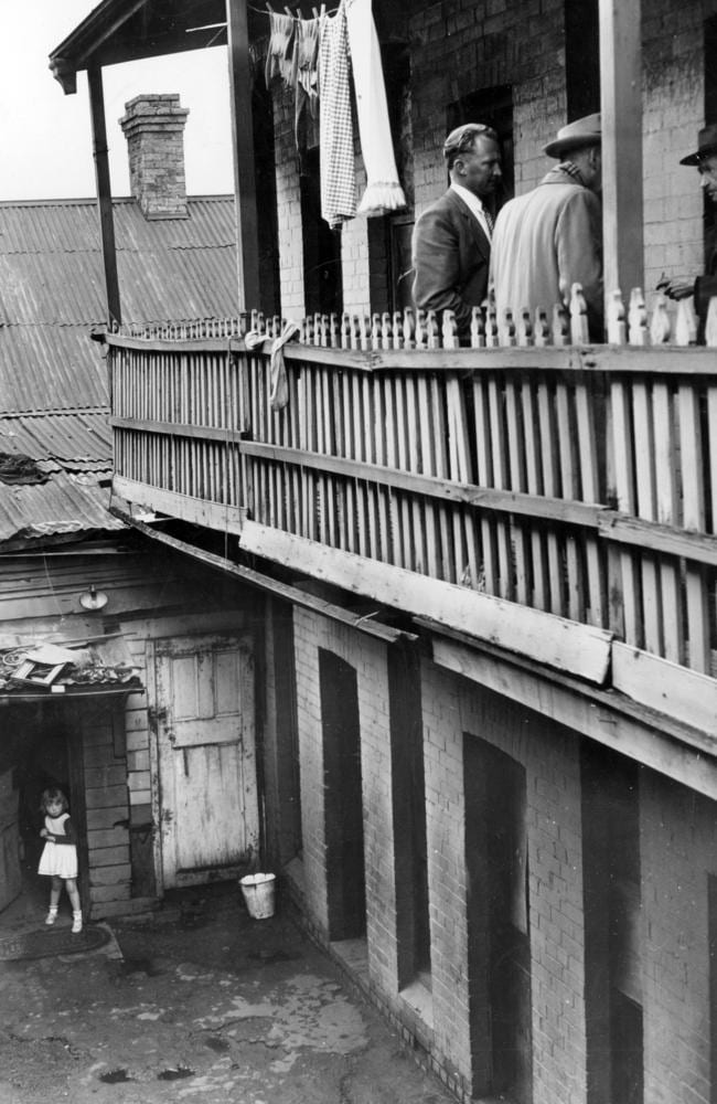 October 1955: Terrace of rooms behind a house at 50 Argyle St. Fitzroy. Tenants paid $1.76 for draughty single rooms. Picture: Herald Sun Image Library/ R McInnes/ ARGUS