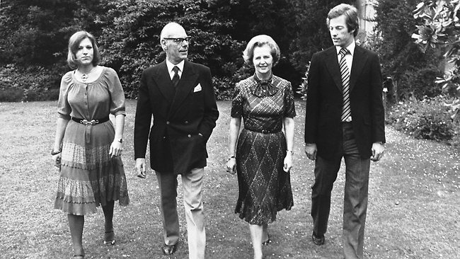 Thatcher takes a stroll through the grounds of Scotney Castle in Kent, England with her husband Denis, and their twins Mark and Carol, in March 1979, after Thatcher was elected Conservaite Party leader. Picture: AP