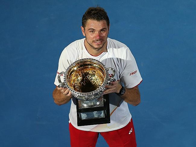 Stanislas Wawrinka with the Australian Open trophy after defeating Rafael Nadal in the final. Picture: Wayne Ludbey