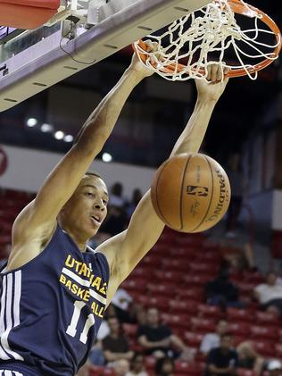 Exum dunks for the Utah Jazz during the first half of an NBA summer league basketball game against the Denver Nuggets in Las Vegas last week. (AP Photo/Isaac Brekken)