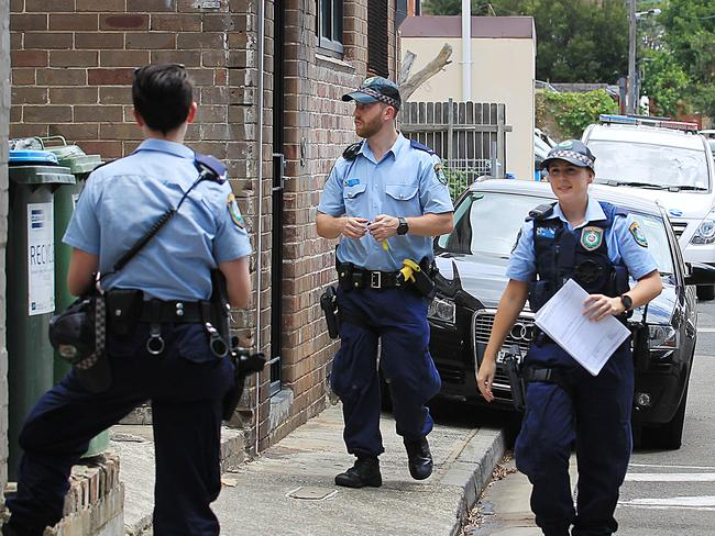 Police arriving at the unit where two bodies were found above 85 King Street in Newtown.