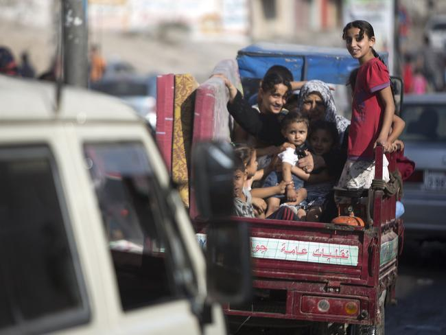 Palestinian families ... leave their homes in Gaza City's Shejaiya neighbourhood in fear of Israeli attacks, after Palestinian factions in Gaza refused to extend the 72-hour ceasefire with Israel. Picture: AFP