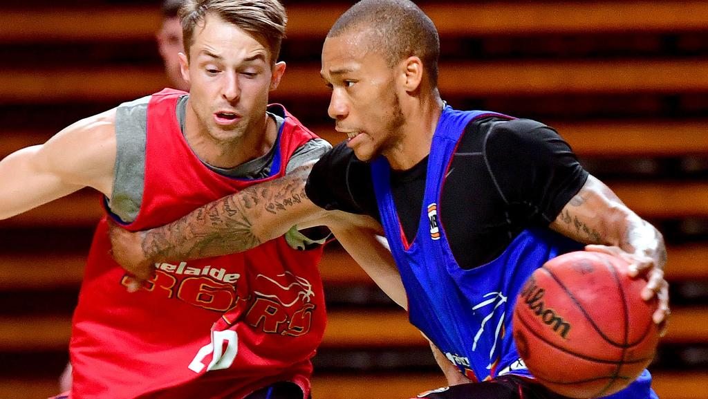 Jerome Randle takes on Nathan Sobey at Sixers training. The two are now both on the NBL free agents list. Picture: Mark Brake