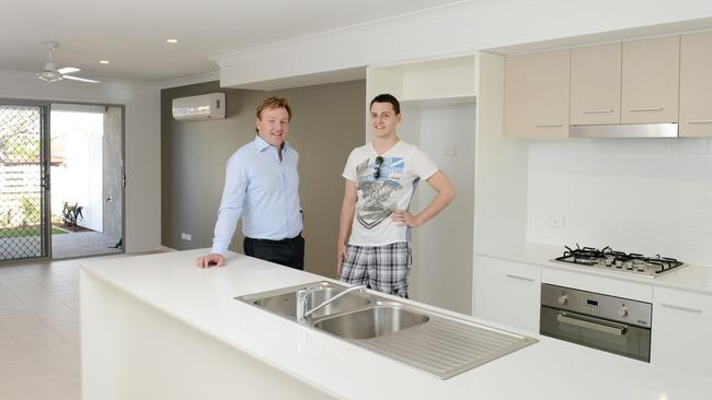 New resident Micheal Longhurst with Consolidated Properties' Lachlan Grantley. Photo by Stuart Quinn.