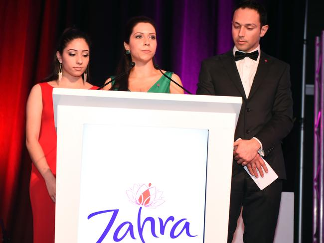 Anita, Atena and Arman Abrahimzadeh speaking on stage about their late mother at the Zahra Foundation Evening at the Adelaide Convention Centre. Photo Tom Huntley