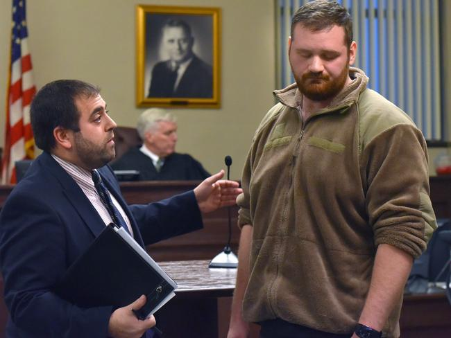 Lawyer Ben Hirshfield, left, stands with his client Joseph Irwin during an indictment hearing. Picture: Mark DiOrio/Observer-Dispatch via AP.