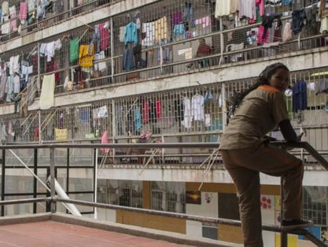 El A guard keeps watch inside the notorious El Buen Pastor prison for women in Bogota, Colombia. Picture: Supplied
