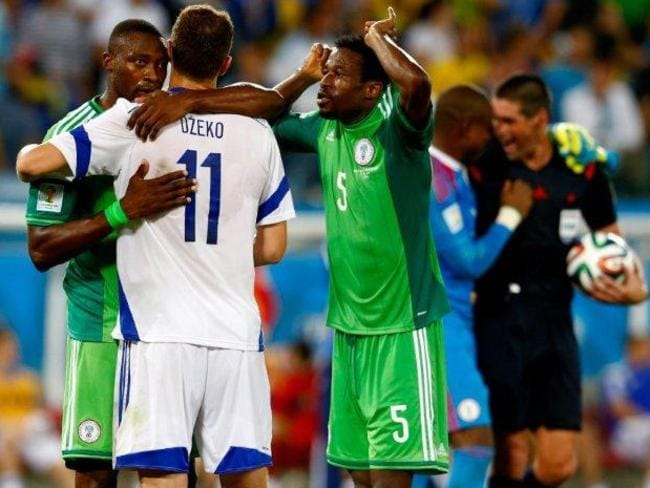 The photo that has angered Bosnia-Herzegovina fans. Referee Peter O'Leary can be seen in the background sharing a moment with a Nigeria player.