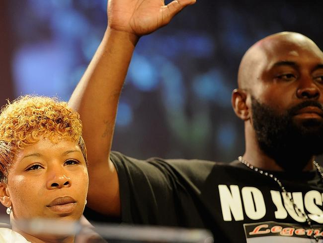 Family grief ... Michael Brown's parents — Lesley McSpadden and Michael Brown Sr. — appeared on stage at a rally at Greater Grace Church on Sunday. Picture: Michael B. Thomas