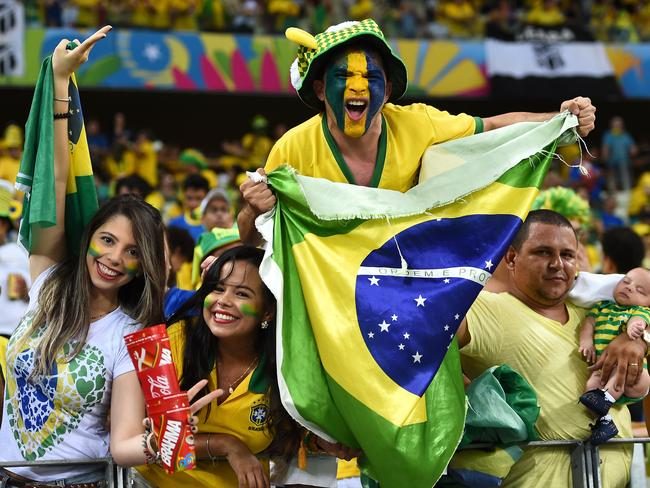 Brazil fans cheer during the 2014 FIFA World Cup Brazil Quarter Final match between Brazil and Colombia.