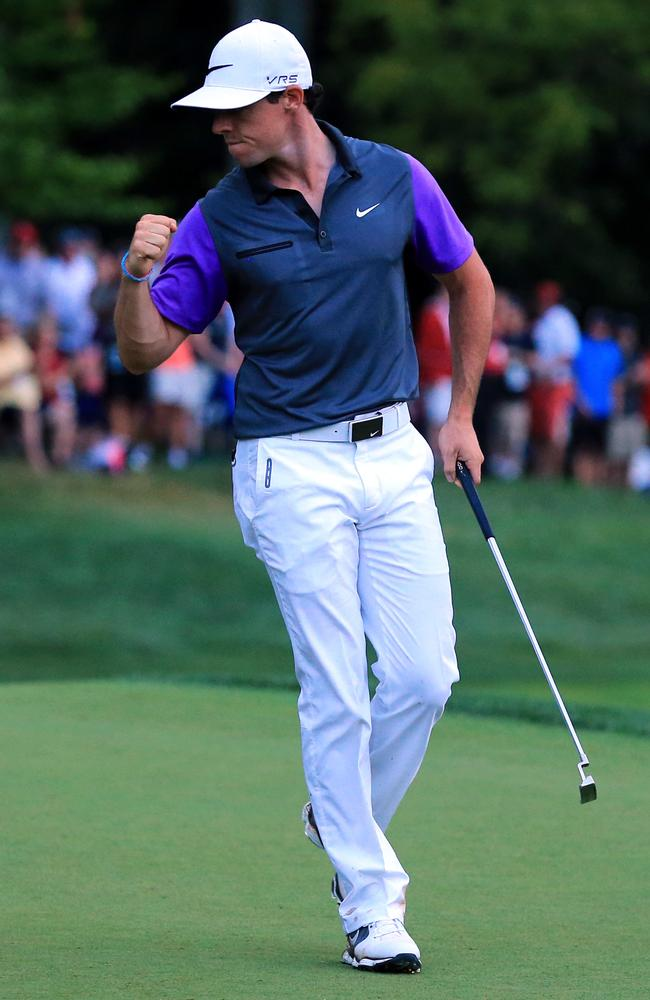 Rory McIlroy is pumped as he sinks a putt on the 17th green of the PGA Championship at Valhalla Golf Club.