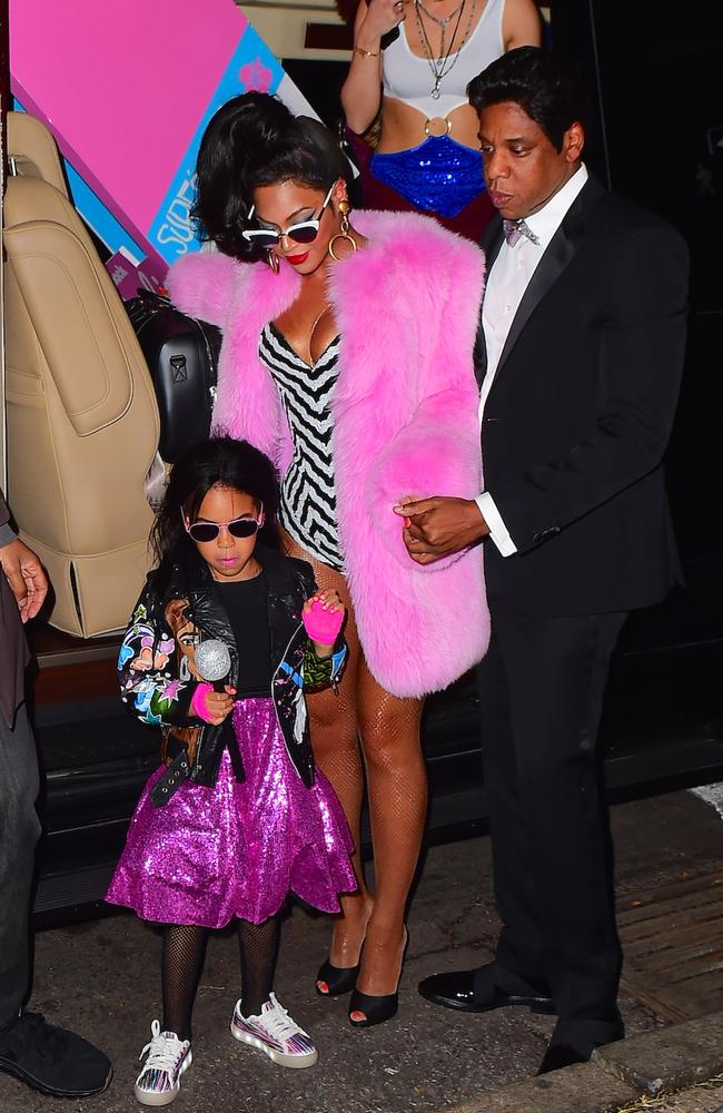 Blue Ivy, wearing pink sequins as only she can, with her parents, Beyonce and Jay Z, on Halloween Picture: Splash
