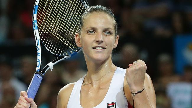 Karolina Pliskova celebrates winning the Brisbane International women's final against Alize Cornet.