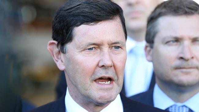 "The guy in the background can hardly bear to watch as Defence Minister Kevin Andrews says ""competitive evaluation process"" for the seven-millionth time. Picture: Stephen Laffer"
