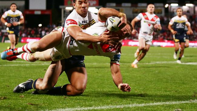 Jason Nightingale scores one of his three tries for the Dragons.