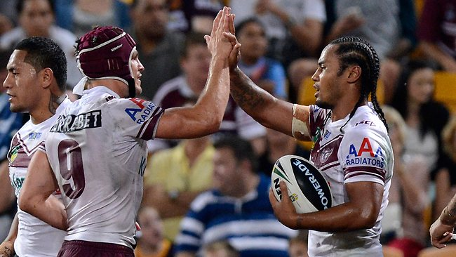 Steve Matai celebrates his first try of the night with teammate Matt Ballin.