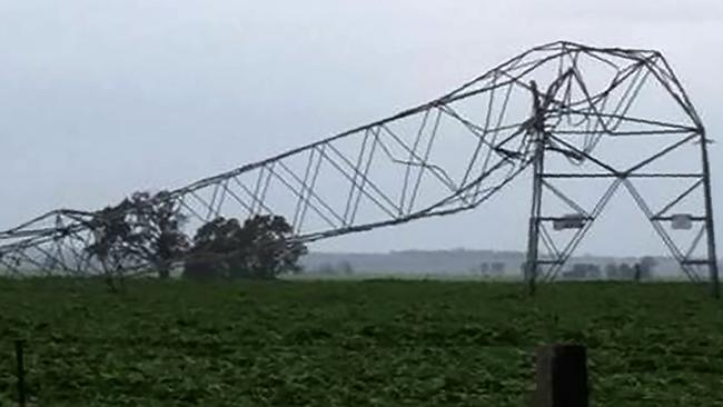 Transmission towers carrying power lines near Melrose were likely toppled by tornadoes and high winds. Picture: Debbie Prosser/AFP