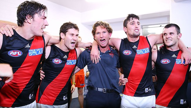 James Hird and the players belt out the team song after beating Fremantle.
