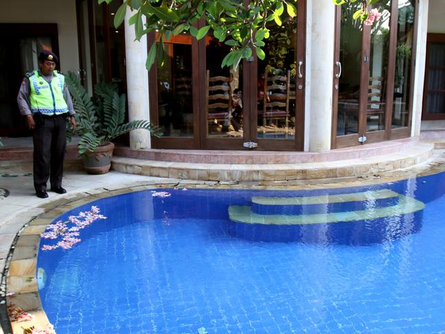 Investigation ... police walk through Villa Emerald no. C 6 in Sanur where British man Robert Kelvin Ellis lived with his Indonesian wife before he was found dead. Picture: Supplied