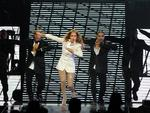 The exit's that way ... Jennifer Lopez performs at Mohegan Sun Arena during its 15th anniversary celebration in Uncasville, Conn., before leaving the stage sobbing after breakign down, on Saturday, Oct. 22, 2011. (AP Photo/Fred Beckham)