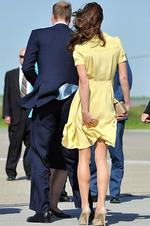 <p>Drafty ... The wind catches Catherine, Duchess of Cambridge's dress as she speaks to soldiers at Calgary Airport on July 7, 2011 in Yellowknife, Canada. Picture: Chris Jackson/Getty Images</p>