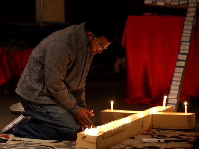 Participants in a vigil at Jacob's Porch are seen praying following the car and knife attack on the campus of Ohio State University in Columbus, Ohio. Picture: AFP