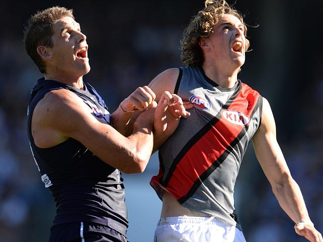 Joe Daniher takes on Aaron Sandilands in the ruck. Picture: Daniel Wilkins