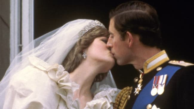 FILE - This is July 29, 1981 file photo of Britain's Prince Charles kisses his bride, Princess Diana, on the balcony of Buckingham Palace in London, after their wedding. Photo: AP Photo, File
