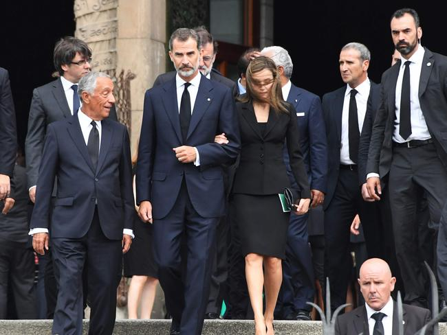 Spain's King Felipe VI (centre), Queen Letizia (right) and Portugal's President Marcelo Rebelo de Sousa (left) leave after a Mass to commemorate victims of two devastating terror attacks in Barcelona. Picture: AFP/Pascal Guyot