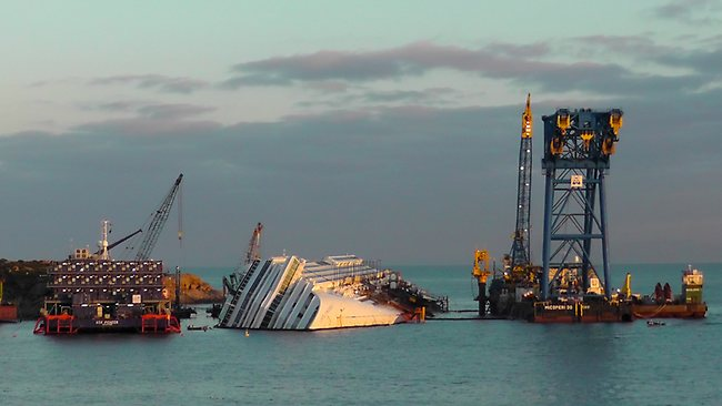 Italian authorities say the capsized cruise ship Costa Concordia will be refloated and removed by September. Picture: AP