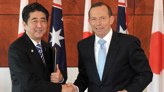 'Special relationship ' ... Japanese Prime Minister Shinzo Abe and Australian Prime Minister Tony Abbott shake hands after signing the Japan-Australia Economic Agreement and the Agreement on the Transfer of Defence Equipment and Technology at Parliament House. Picture: Mark Graham