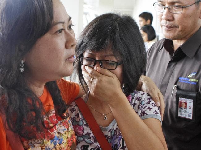 A relative of an Air Asia flight QZ8501 passenger weeps as she waits for the latest news on the missing jetliner at Juanda International Airport in Surabaya, Indonesia.