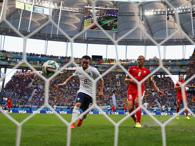 Mathieu Valbuena of France scores his team's third goal during the 2014 FIFA World Cup Brazil Group E match between against Switzerland.