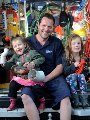 Aaron Stewart juggles work with looking after his daughters, Charli and Madeleine. Picture: Keryn Stevens