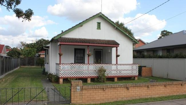 A three-bedroom fibro home on a 582 sqm block at 60 Curtin St, Cabramatta sold for $668,000. NSW real estate.