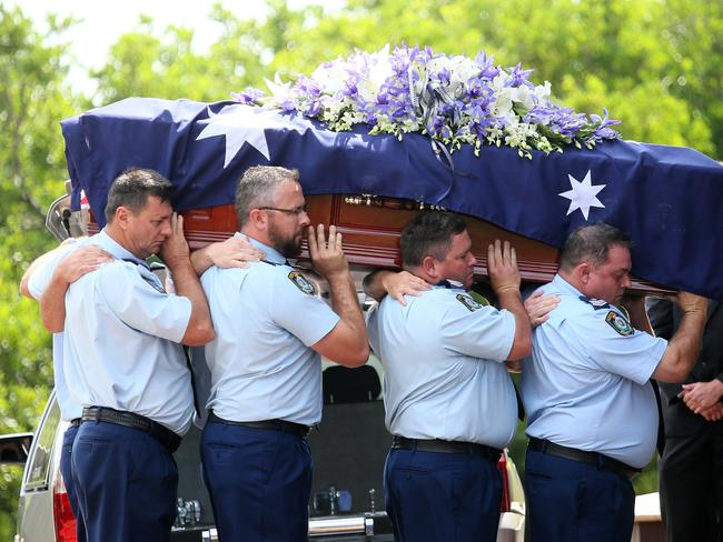 Colleagues carry Sgt Richardson's casket into the church. Picture: Troy Snook