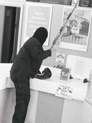 A CCTV image of the bank robber known as the Bicycle Bandit, robbing a bank at Yankalilla in 2007.