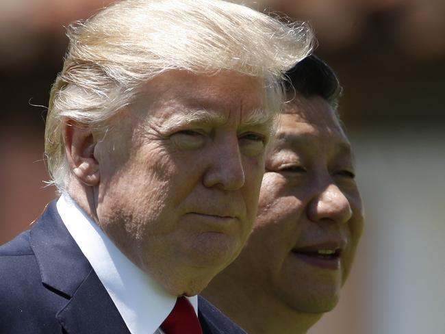US President Donald Trump, left, has been pressuring Chinese President Xi Jinping to play a greater role in the North Korean tensions. Picture: AP/AlexBrandon