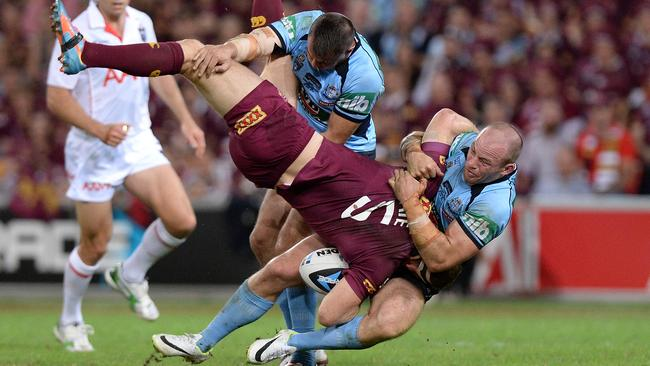 Brent Tate is picked up in the tackle by Josh Reynolds and Beau Scott.
