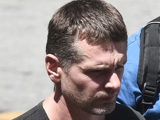 Russian Alexander Vinnik is escorted by police officers as he arrives at a courthouse in Thessaloniki on July 26, 2017. Greek police said that they had arrested a 38-year-old Russian sought by US authorities for allegedly helping criminals launder billions of dollars using Bitcoin. Police said the man, identified as Alexander Vinnik, headed a organisation that has allegedly laundered at least four billion dollars since 2011 using the virtual currency. / AFP PHOTO / SAKIS MITROLIDIS