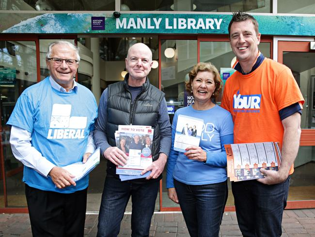 Liberal candidate Pat Daley, Labor candidate, Independent Candy Bingham and Independent Michael Regan handing out how to vote material at Manly Library for pre-polling. Pic: Adam Yip/ Manly Daily