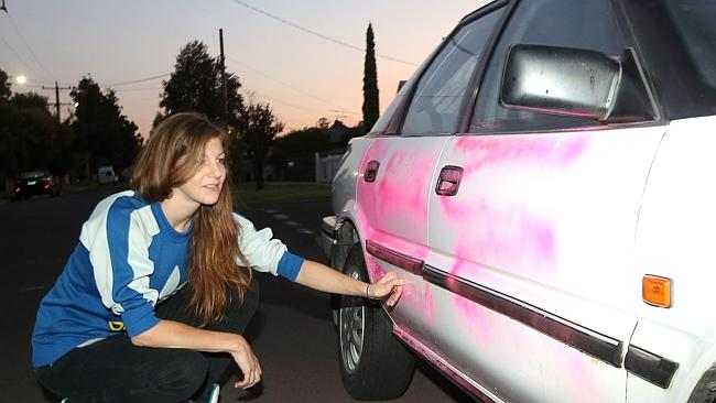 Rachael Eglington inspects damage to her car. Picture: Hamish Blair