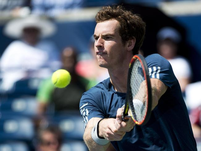 Andy Murray returns the ball against Nick Kyrgios.