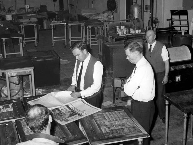 Quality control ... Rupert Murdoch checks pages of The Australian on the presses, July 15, 1964.