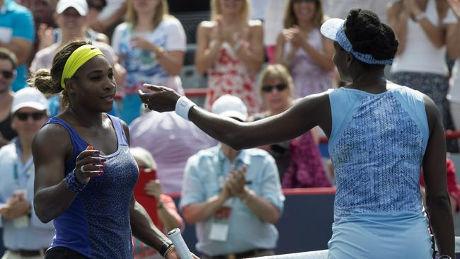 Serena Williams, left, congratulates her sister Venus after winning the semi-final 6-7, 6-2, 6-3 at the Rogers Cup.
