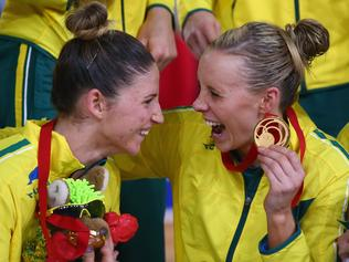Julie Corletto and Renae Hallinan celebrate their victory after the gold medal netball match at the Commonwealth Games.