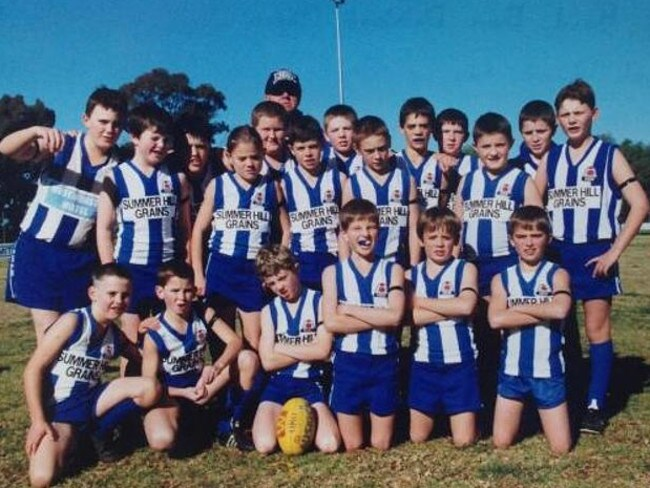 Luke Breust (front row, white/blue mouthguard) and Isaac Smith (second row, on Breust's right shoulder) when playing for the Temora Kangaroos Under 12s/