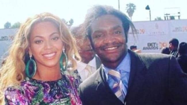 Bryant, pictured with Beyonce.